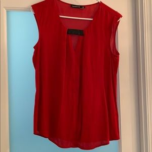 Red sleeveless top.